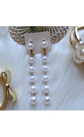 Pendientes largos perlas...